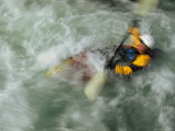 Man Kayaking a Rapid Called Iron Curtain