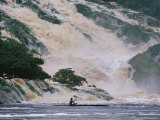 A Man on a Canoe Near the Crashing Waters of Kongou Falls