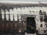 The Burnt out Hull of a Jet Sits on a Tarmac