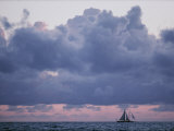 Distant Sailboat under Dramatic Clouds