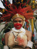 A Tribal Woman Decorated with Beads  Feathers  and Cowries