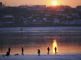 Sunset Scene with Fishermen on the Ice