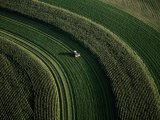 Aerial View of a Tractor on Curved Fields
