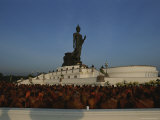 Monks Gather at a Statue of Buddha for a Kings Birthday Celebration