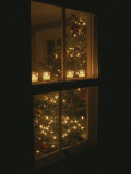 View of Candles and a Christmas Tree Through a Window