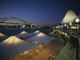 The Harbour Bridge and Opera House Frame an Outdoor Restaurant