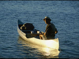 A Canoe Camper Paddles on Lake Richie