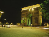 Traffic Whizzes Past Pariss Arc De Triomphe at Night