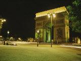 Traffic Whizzes Past Pariss Arc De Triomphe at Night