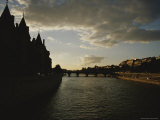 Silhouetted Buildings Along the Seine River at Dusk