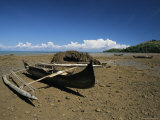 An Outrigger Canoe Sits on a Deserted Beach