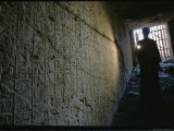 A Man Illuminates a Relief at the Entrance to Ramses Iis Tomb