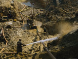Gold Miners Blast Muddy Holes in the Earth with Water