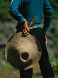 A Farmer Holding a Hat and Knife Near Guilin