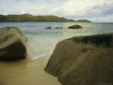 Smooth Rocks Lie on a Beach in the Seychelles
