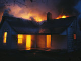 A House is Engulfed in Flames in a Firefighting Exercise