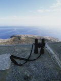 A Pair of Binoculars Rest on a Rock at a Scenic Overlook on the Ocean