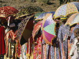 Brightly Colored Umbrellas and Robes Liven an Epiphany Procession