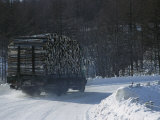 A Lumber Truck Travels Along a Winding  Snow-Covered Hokkaido Road