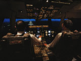 Pilots Sitting in the Cockpit at Night