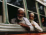 Indian Tourists Stare Out of the Window of a Tourist Bus in Agra; the Bus is Near the Taj Mahal