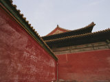 A View of a Wall and the Peak of a Roof of the Forbidden City