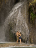 A Couple Hug Next to a Cool Waterfall in the Grand Canyon