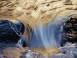 Water Flows Swiftly Between Two Rocks