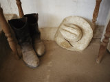 Cowboy Boots and Hat Lie under a Table