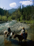 Horseback Riders Stand in Coffee Creek