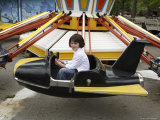 A 6-year-old Girl Rides a Vintage Carnival Ride