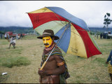 A Huli Warrior Takes Advantage of an Umbrella to Keep Himself Dry