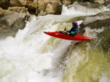 A Kayaker Careens over a Waterfall into the Swirling Whitewater Below