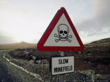 A Roadside Sign Warns Travelers of the Thousands of Mines