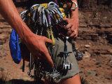 A Rock Climber Check Her Gear Before a Climb