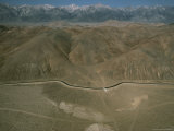 An Aerial View of a Mountain Valley Bisected by a Road