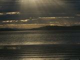 Sunlight Pierces the Clouds over the Coast of Tasmania