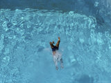 A Swimmer Dives into a Swimming Pool