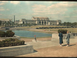 Two Women Look Across Captial Park and its Reflecting Pool Toward Union Station