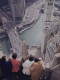Tourists Looking Down on the Chicago River from the Tribune Building