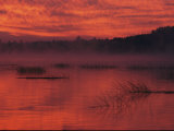 Red-Orange Sky Reflected in Lake Water