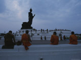 Buddhist Monks Meditate at a Statue of Buddha in Bangkok