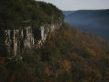 Cliffs Rise Above the Autumn-Colored Valley Floor