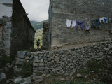 A Hiker Walks Between Houses in the Coruh Valley Region