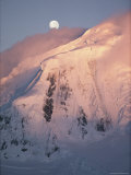 The Moon Rises over Snow- Blown Peaks on Anvers Island