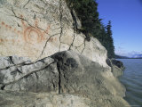 A Petroglyph Decorates a Waterside Cliff
