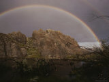 A Perfect Rainbow Arches over a Beaver Pond Protected by an Outcropping of Rock