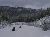 Snowmobilers in Yellowstone National Park  Wyoming