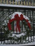 Fresh Snow Covers a Christmas Wreath on the White House Gate