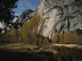 Scenic Autumn View of the Merced River Winding Below Huge Cliffs